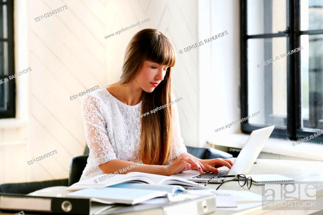 Stock Photo: Beautiful girl in the office.