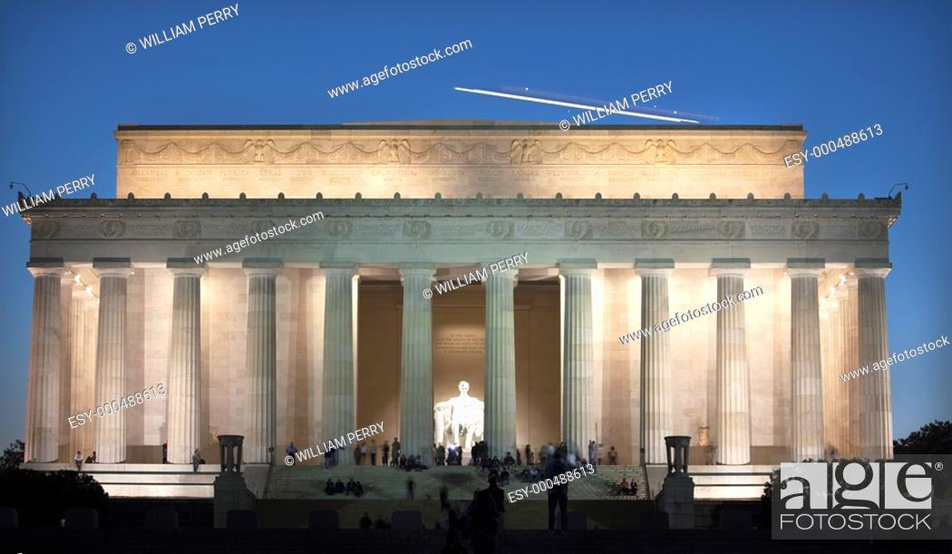 Stock Photo: Airplane Over Lincoln Memorial White Statue Evening Washington DC Faces Blurred by Long Exposure.