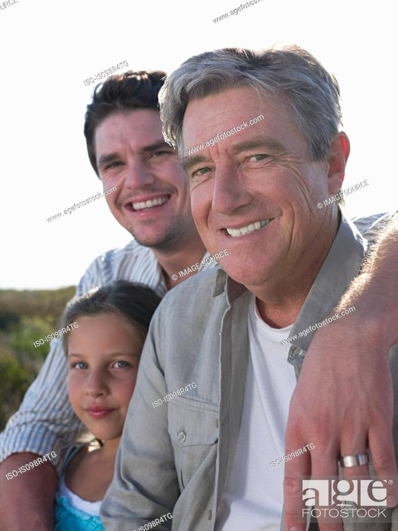 Stock Photo: Girl with father and grandfather.