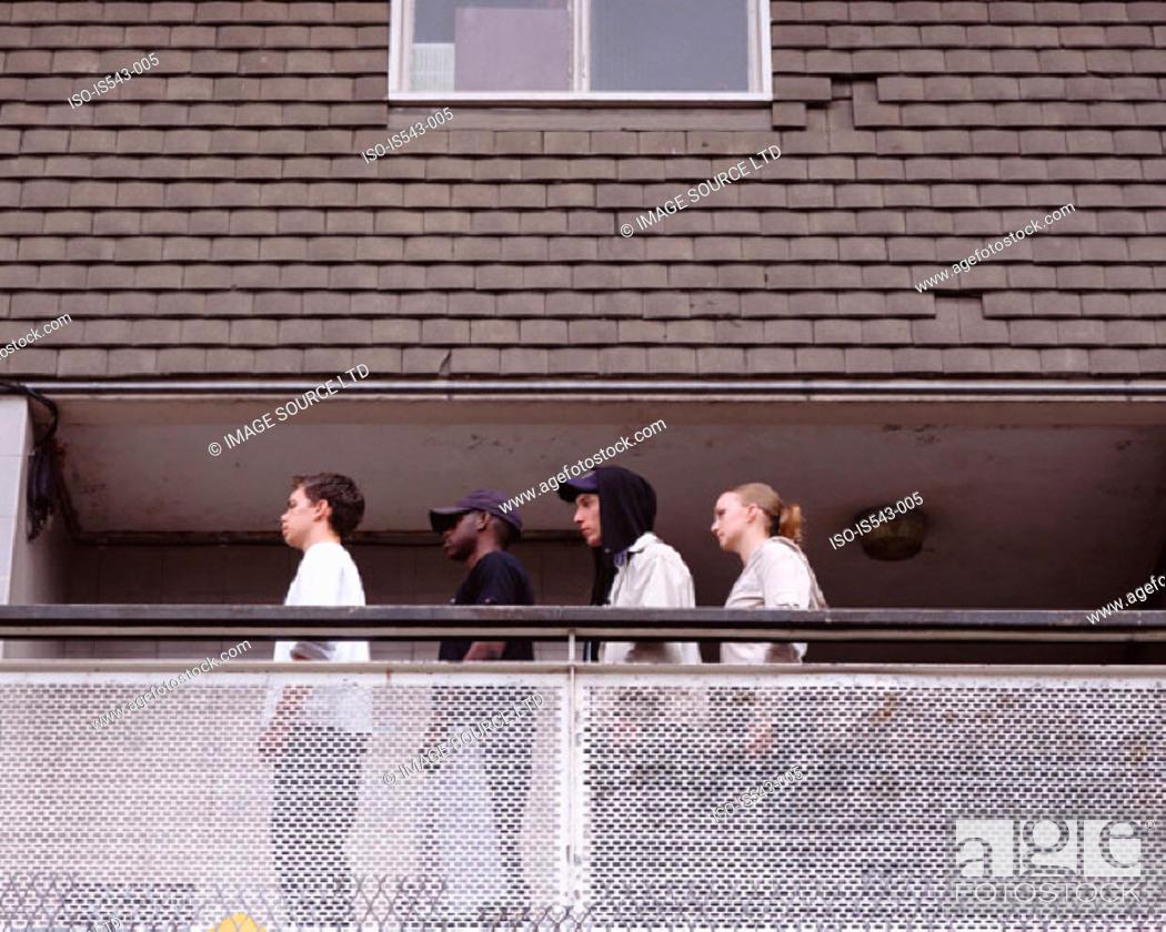 Stock Photo: Teenagers standing on balcony.