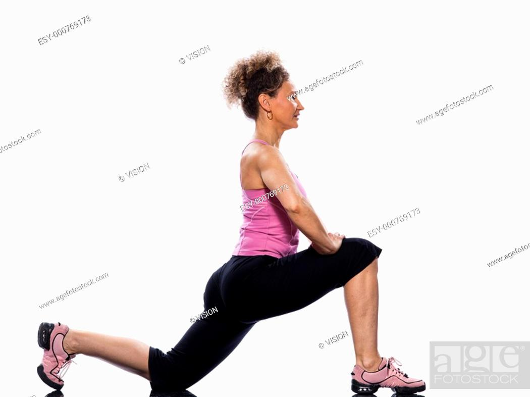 Stock Photo: beautiful mature woman on isolated white background doing stretching exercise.