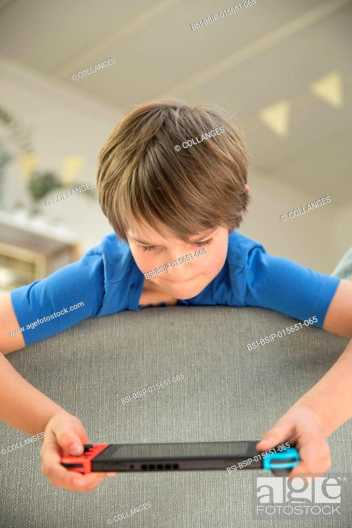 Stock Photo: Boy playing video game.