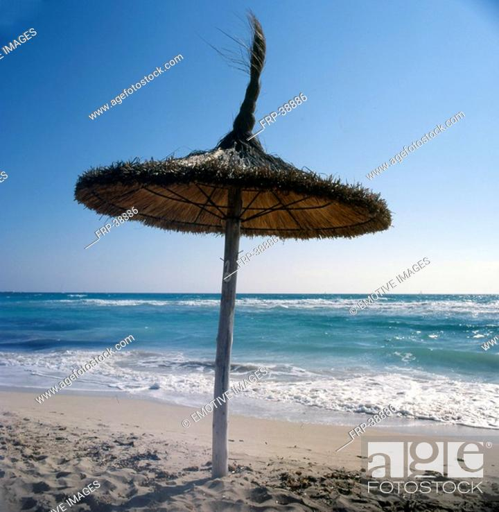 Stock Photo: Parasol made of straw on the beach.