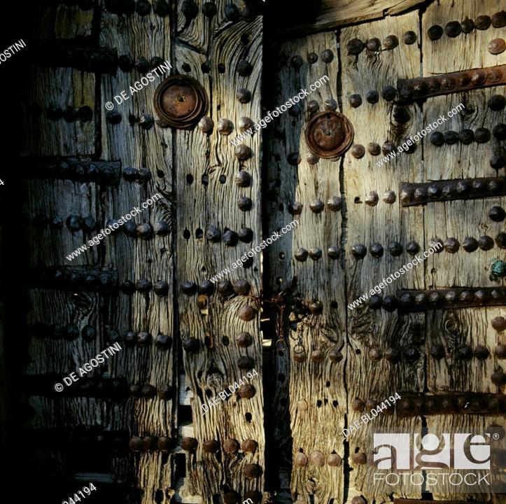 Stock Photo: Wooden door studded with bolts, Monodendri Zagoria, Epirus, Greece.