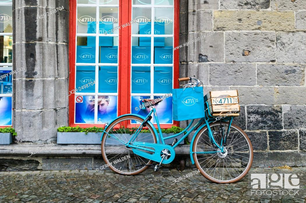 Stock Photo: Promotional bicycle outside the 4711 cologne store in the centre of Brugge, Belgium.