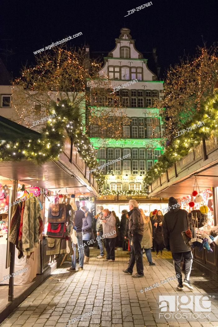 Stock Photo: Christmas market at the home of the Heinzelmannchen on Heumarkt square, Cologne Germany.