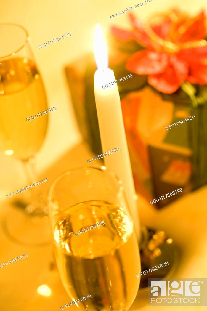 Stock Photo: Champagne and Candle.