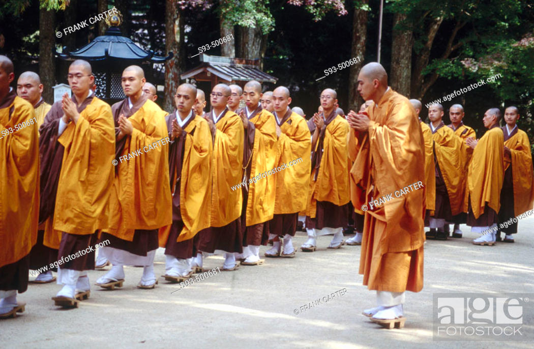 Stock Photo: Student monks walk along while a teacher watches closely. Kongobuji. Koyasan. Japan.