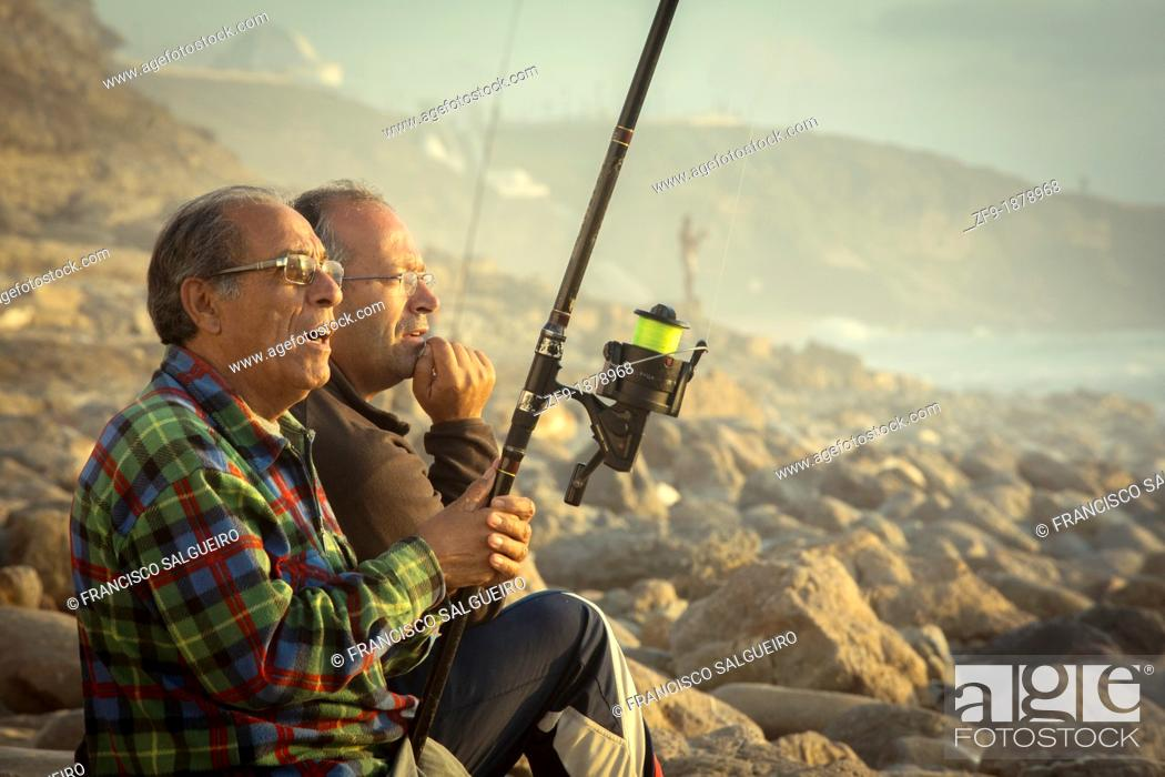 Stock Photo: Two friends fishing in Ericeira.