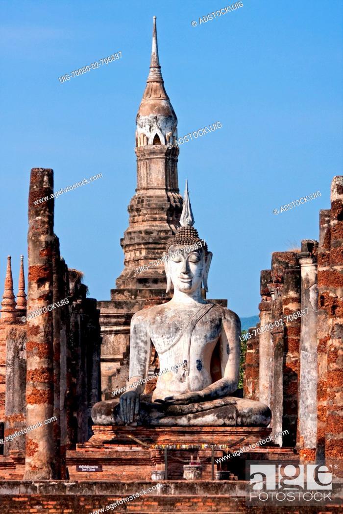 Stock Photo: Sitting Buddha inside Wat Mahathat, Sukhothai, Thailand.