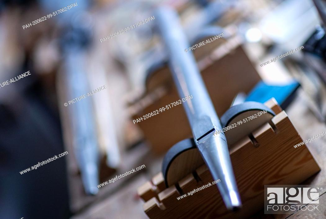 """Stock Photo: 22 June 2020, Mecklenburg-Western Pomerania, Rostock: A metal pipe for an organ repair can be found in the workshop """"""""Historical Keyboard Instruments -."""