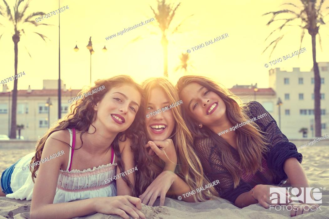 Stock Photo: Best friends girls at sunset beach sand smiling happy together.