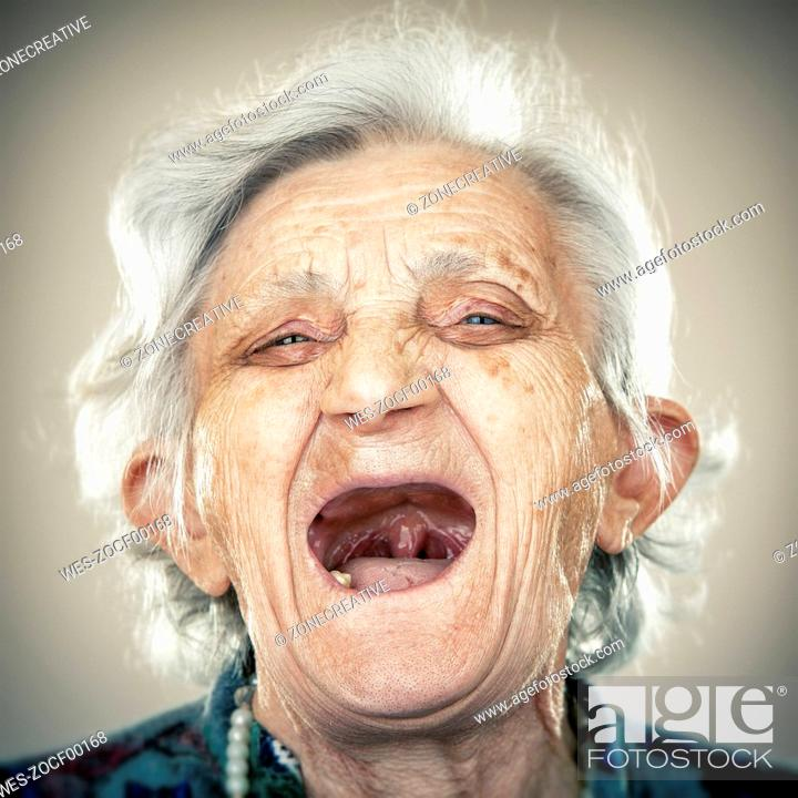 Stock Photo: Portrait of an elderly lady, laughing out loud.