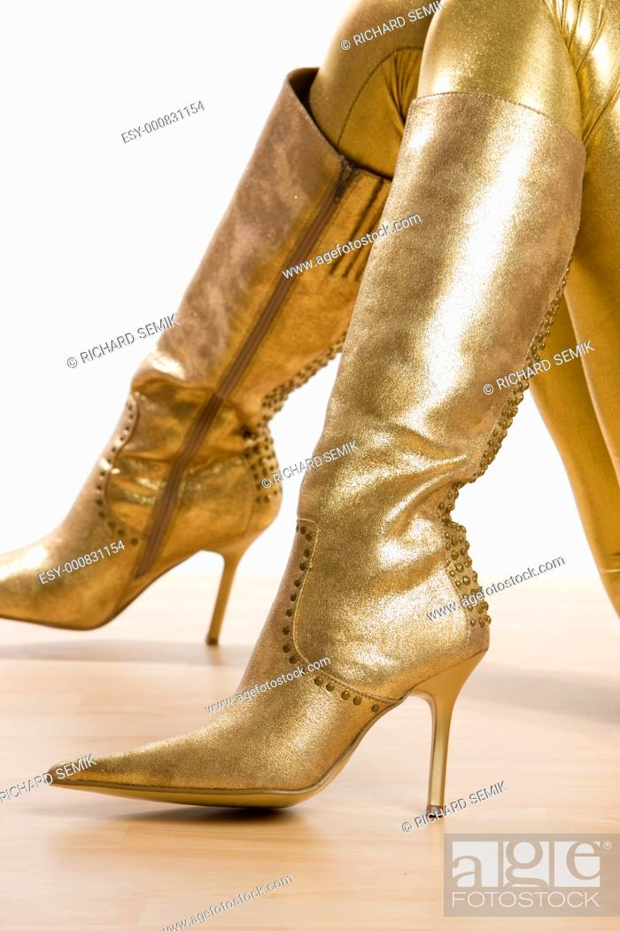 Stock Photo: golden boots.