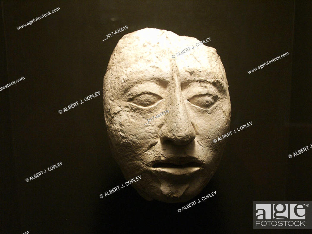 Stock Photo: Human skull carving from Palenque, Maya archeological site (600 - 800 A.D.). Chiapas, Mexico.