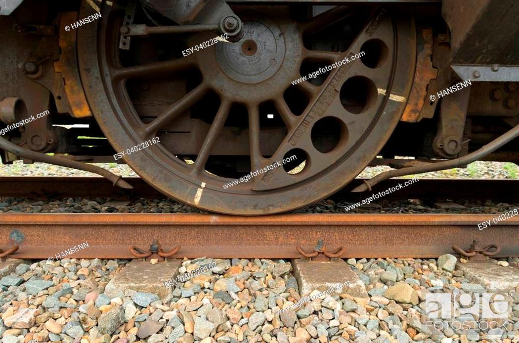 Stock Photo: closeup of a train wheel.
