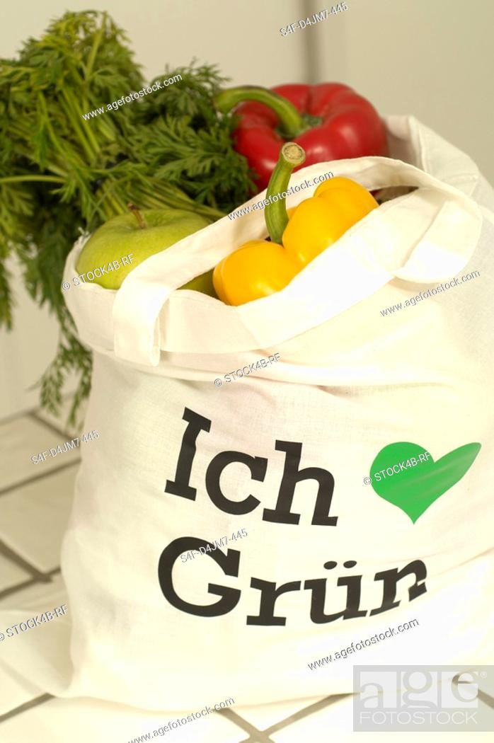 Stock Photo: Shopping bag filled with organic products.