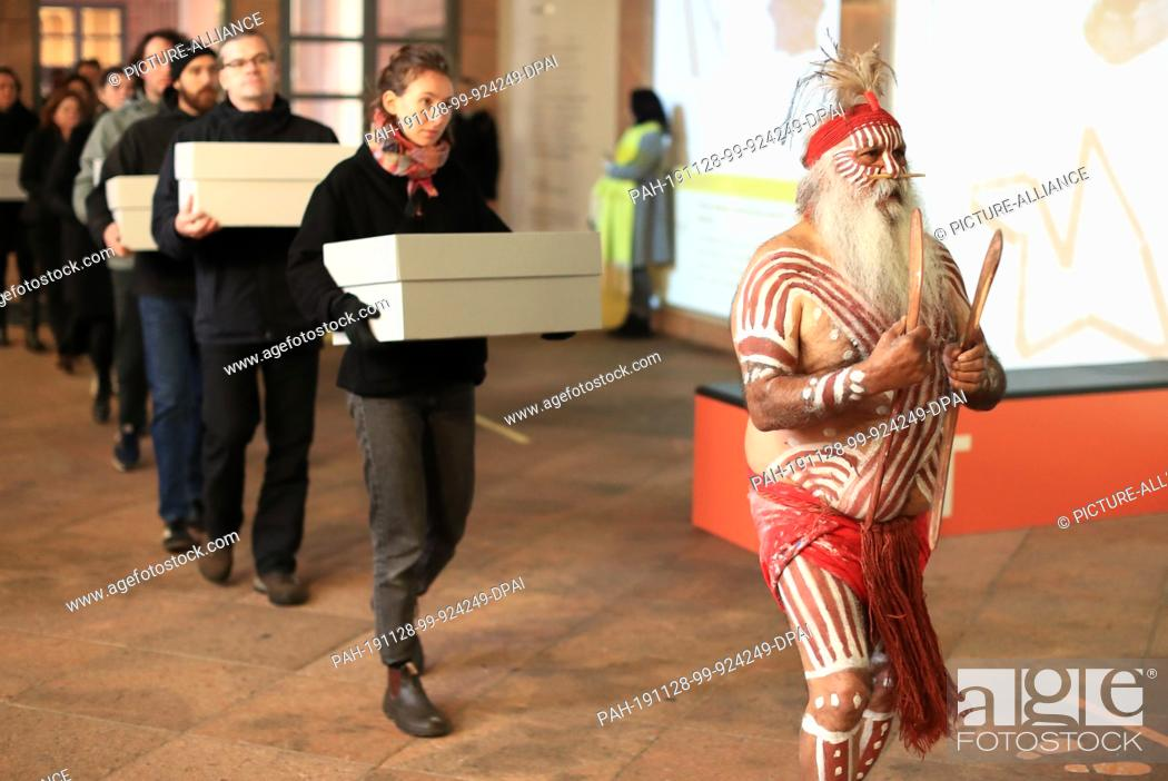 Stock Photo: 28 November 2019, Saxony, Leipzig: Major Sumner, representative of the Australian Ngarrindejeri Community, leads a procession in the Grassi Museum on the.