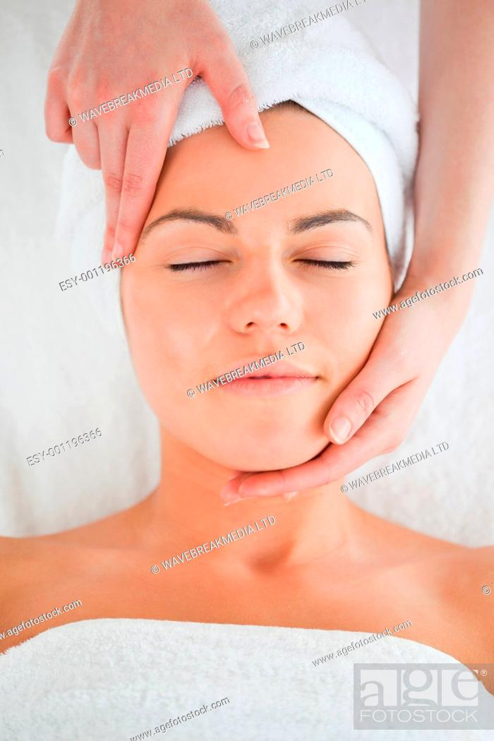 Stock Photo: Portrait of a woman enjoying a facial massage in a spa.