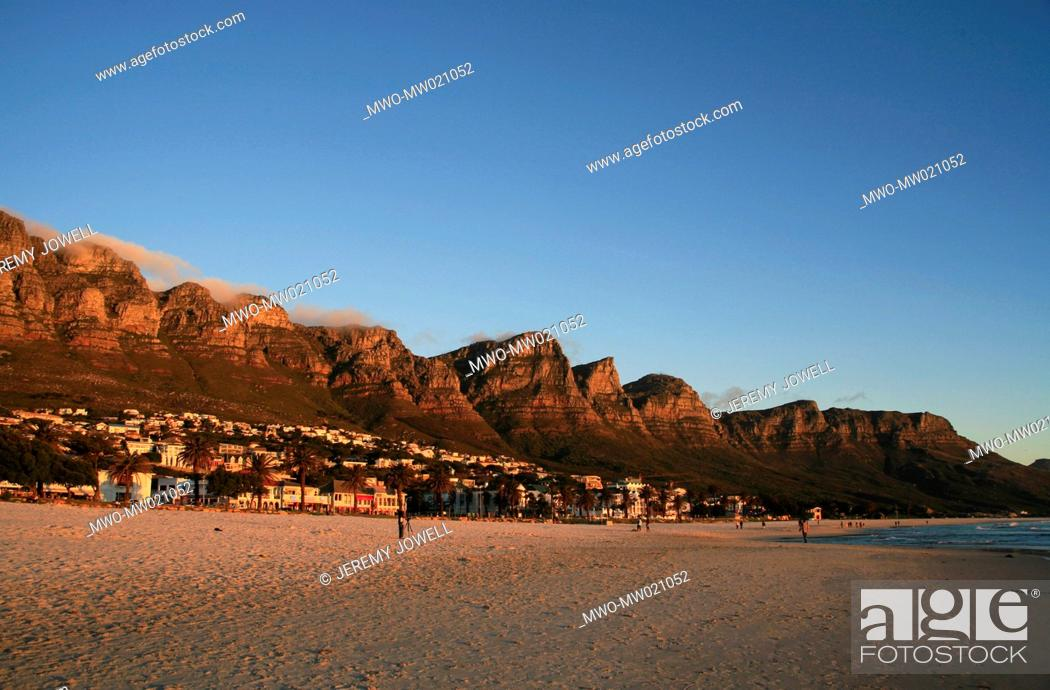 Sunset At Camps Bay Beach With Twelve Apostles Mountains In