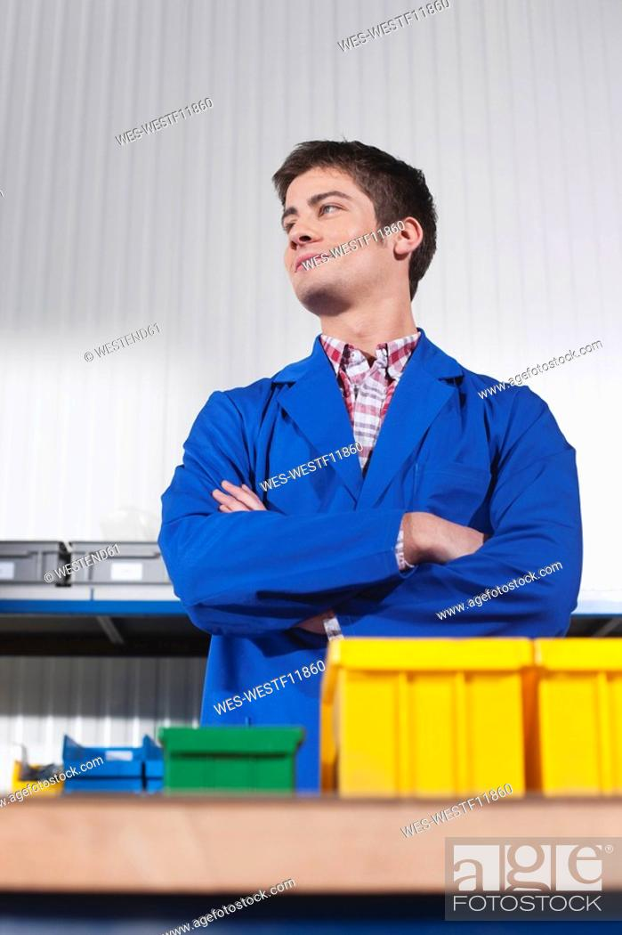 Stock Photo: Germany, Neukirch, Apprentice, arms crossed, portrait.
