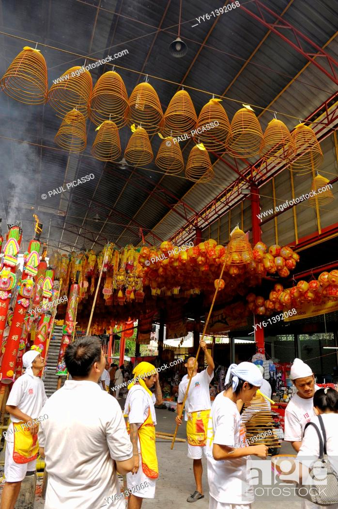 Stock Photo: Devotees hang incense swirls and ceremonial lanterns high among the rafters , Vegetarian festival at San Jao Sieng Kong shrine , wat sung heng yee, Chinatown.