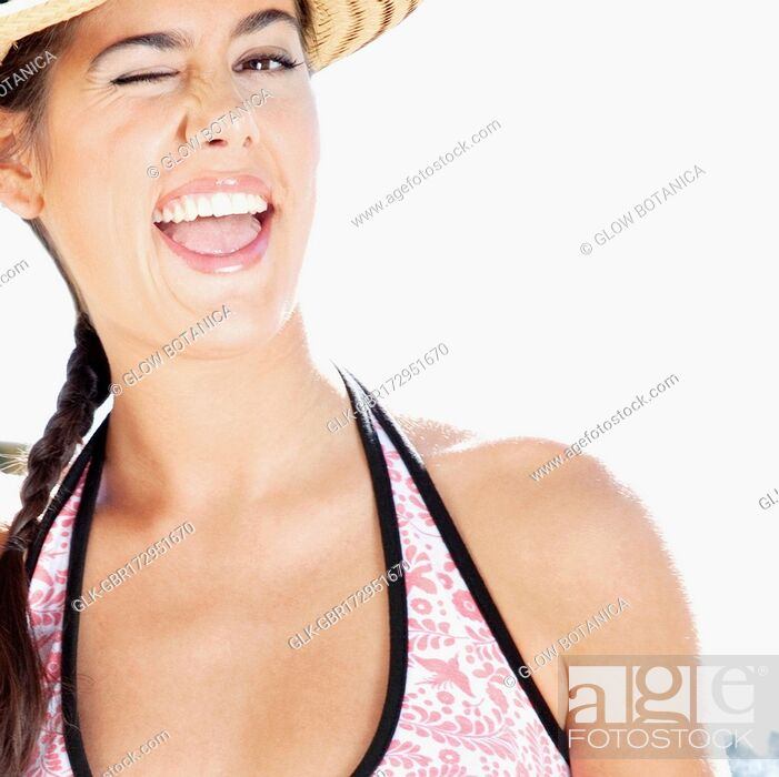 Stock Photo: Close-up of a woman winking.