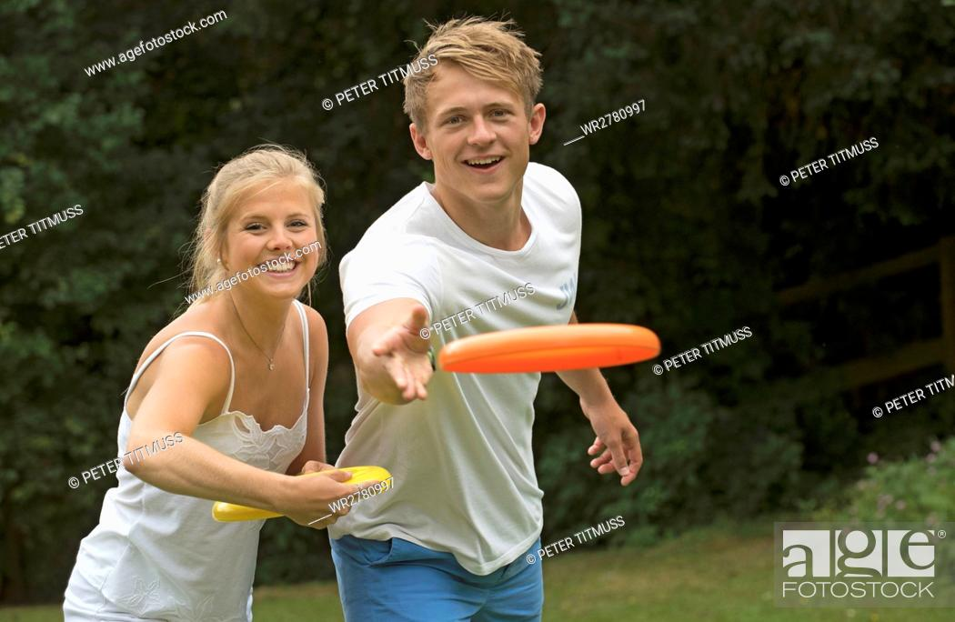 Stock Photo: Young couple playing a flying disc game.