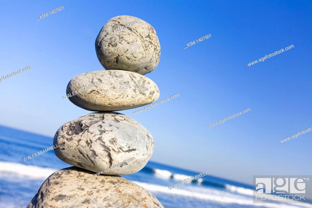 Stock Photo: Stone stack with blue sky and angled horizon.