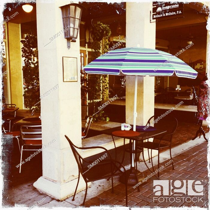 Stock Photo: A table and chairs for two at an outdoor cafe in Florida.