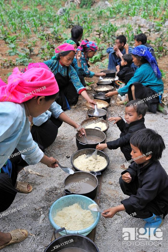 Stock Photo: H'mong women taking communal lunch during funeral in a village around Sa Phin,Ha Giang province,Northern Vietnam,southeast asia.
