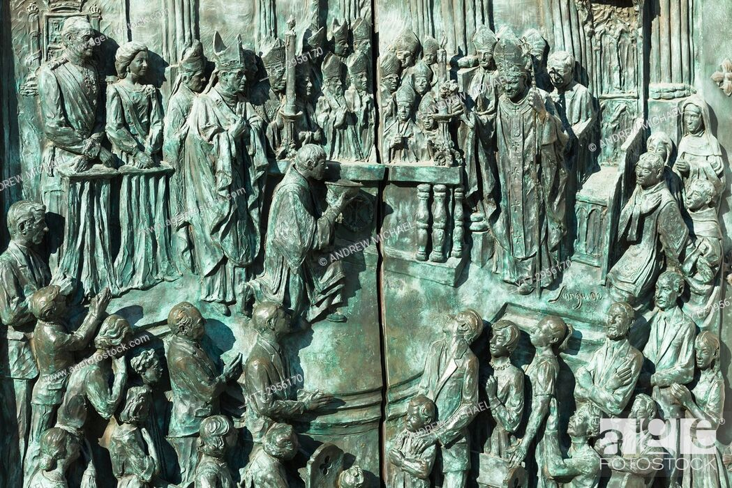 Stock Photo: Almudena Cathedral, Santa María la Real de La Almudena. Detail of bronze doors at entrance. Madrid, Spain.