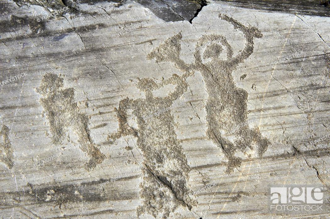 Photo de stock: Petroglyph, rock carving, of two warriors one wearing a helmet and carrying a sword and shield. Carved by the ancient Camuni people in the iron age between.