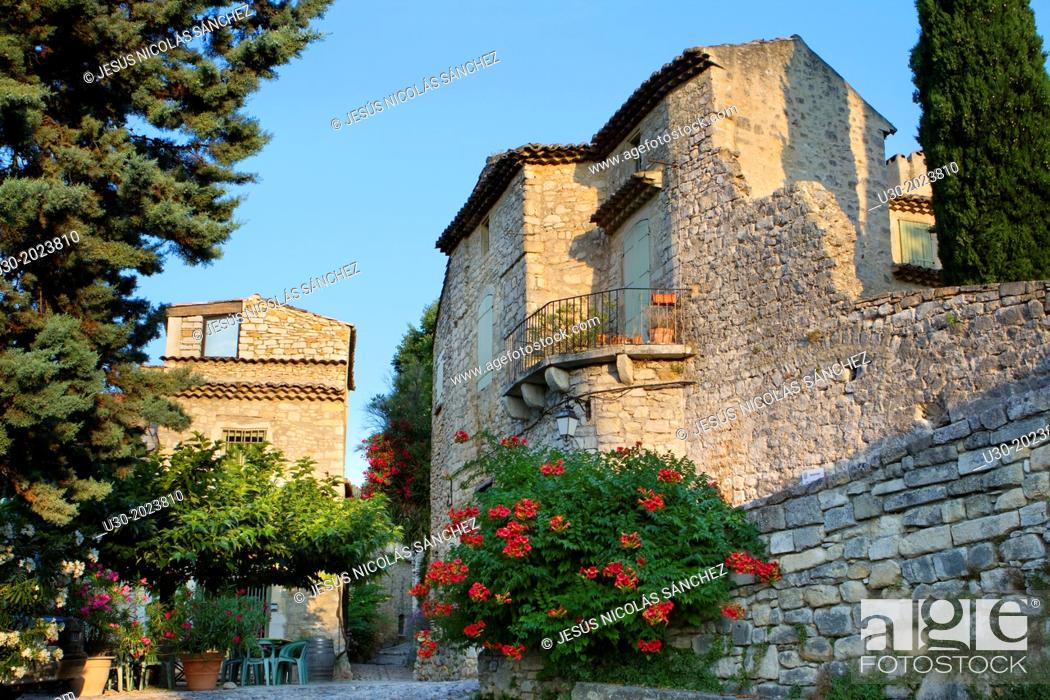 Stock Photo: Typical street in Roque-sur-Ceze, labelled The Most Beautiful Villages of France. Gard deparment, Languedoc-Roussillon region. France.