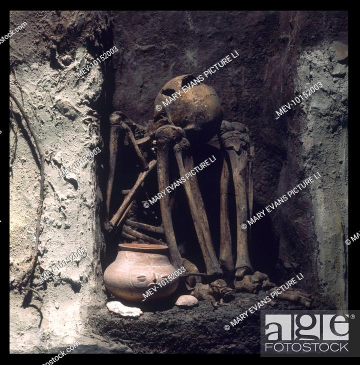 A Skeleton of a Maya tomb with its gifts in the National