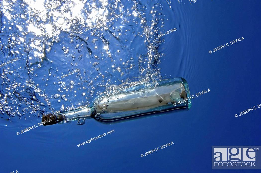 Stock Photo: Message in a bottle, underwater view.