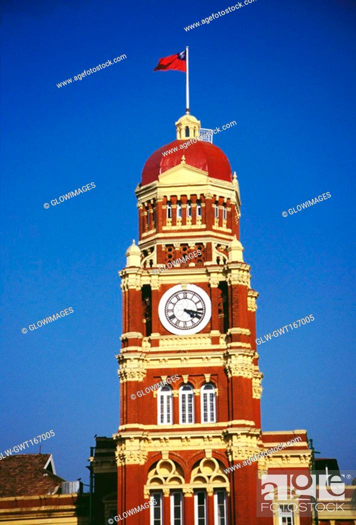 Stock Photo: Low angle view of a clock tower of a government building, Supreme Court, Yangon, Myanmar.