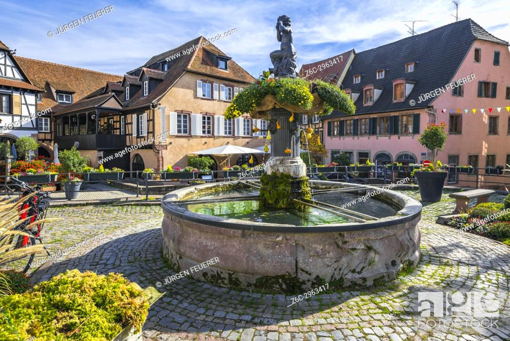Stock Photo: fountain and old houses in the centre of the village Barr, on the Wine Route of Alsace, France.