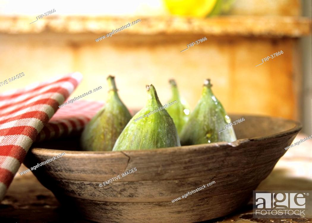 Stock Photo: Fresh figs in a wooden bowl.