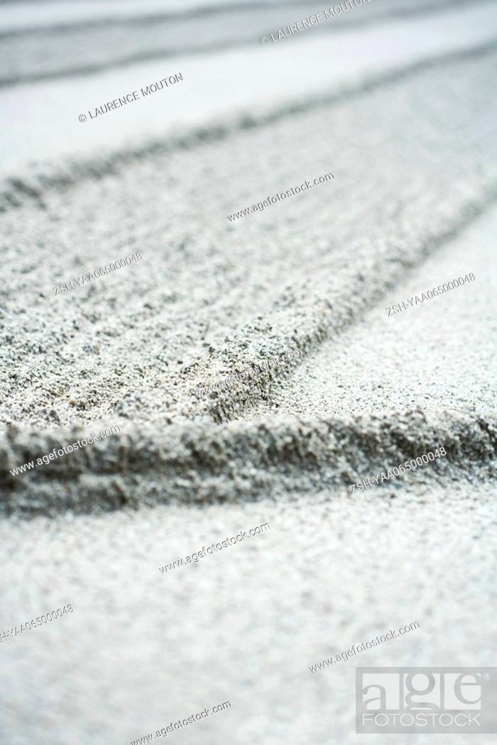 Stock Photo: Patterned sand in rock garden, extreme close-up.