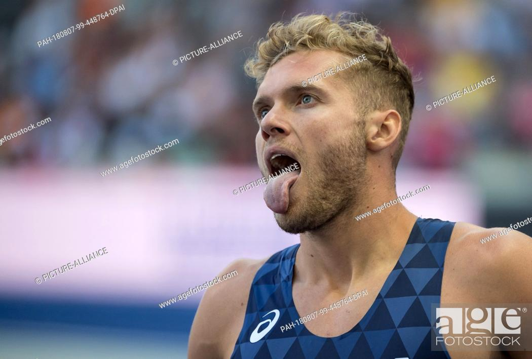 Stock Photo: 07.08.2018, Berlin: Track and Field, European Championships in the Olympic Stadium, Decathlon 100m, Men. Kevin Mayer from France sticks out his tongue at the.