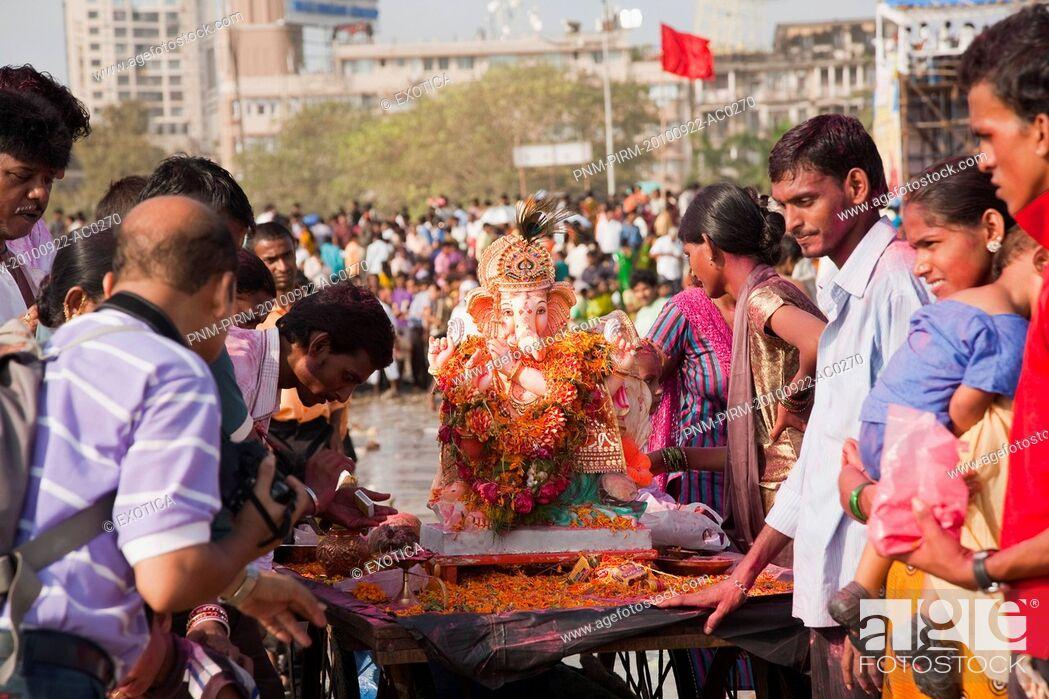 Stock Photo: People at the immersion ceremony of Lord Ganesha, Mumbai, Maharashtra, India.