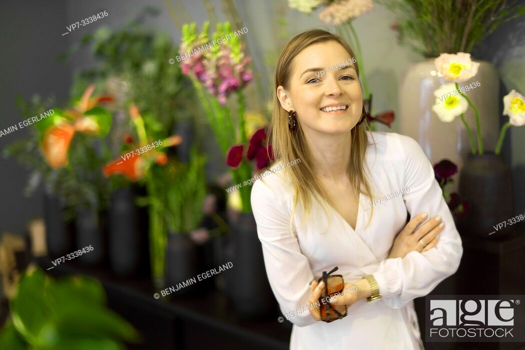 Stock Photo: woman next to flowers.