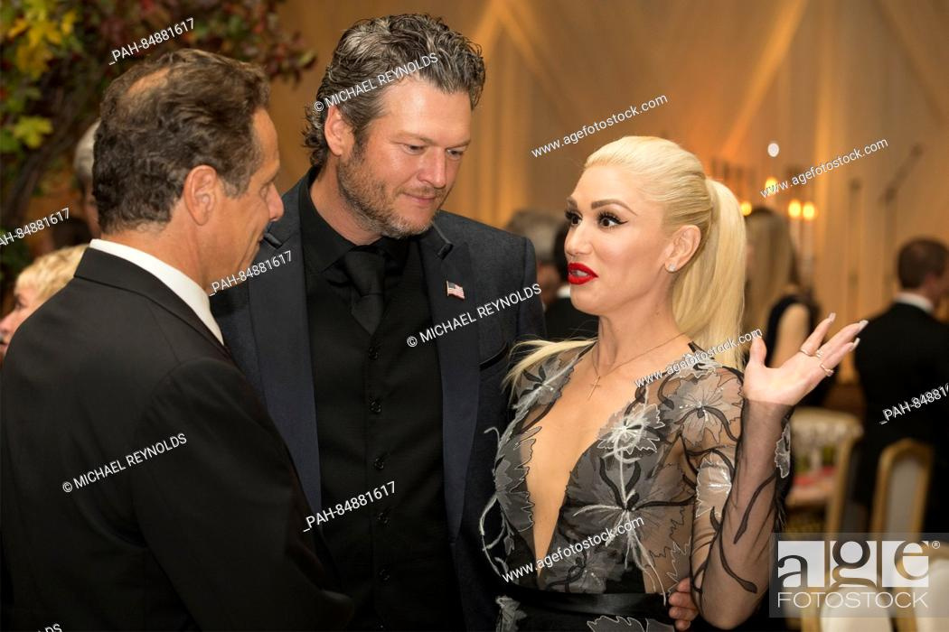 Stock Photo: US entertainer Gwen Stefani (R), US entertainer Blake Shelton (C) and New York Governor Andrew Cuomo (L) attend a state dinner for Italian Prime Minister Matteo.
