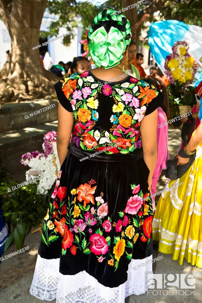 Stock Photo: Rear view of a woman standing in wedding ceremony, Oaxaca, Oaxaca State, Mexico.
