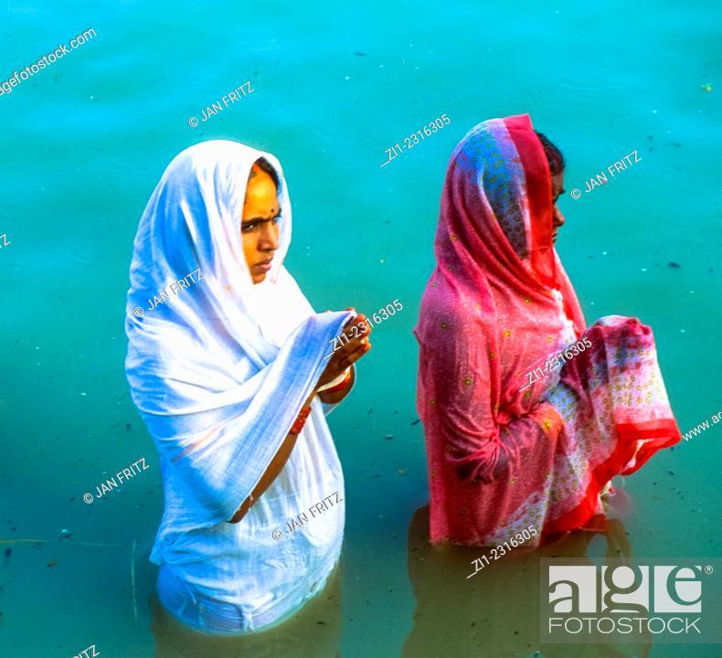 praying pregnant women at Ganga river in varanasi, india, Stock