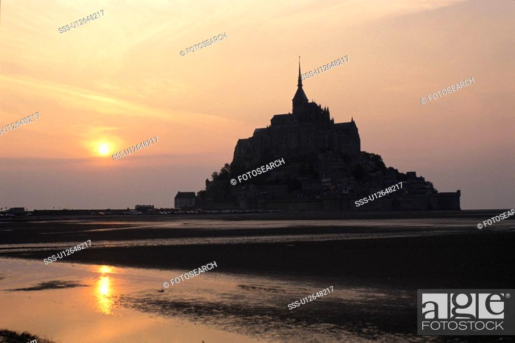 Stock Photo: The Morning Sun And Mont-Saint-Michel In France.