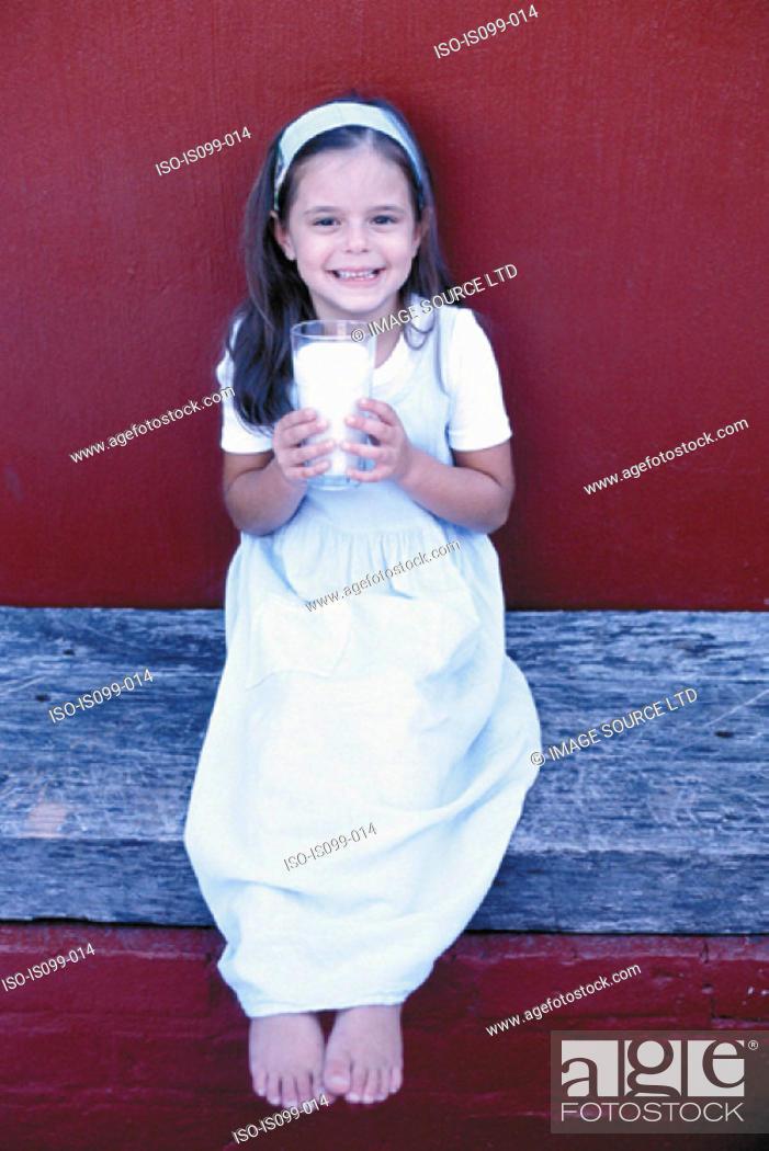 Stock Photo: Girl drinking milk.