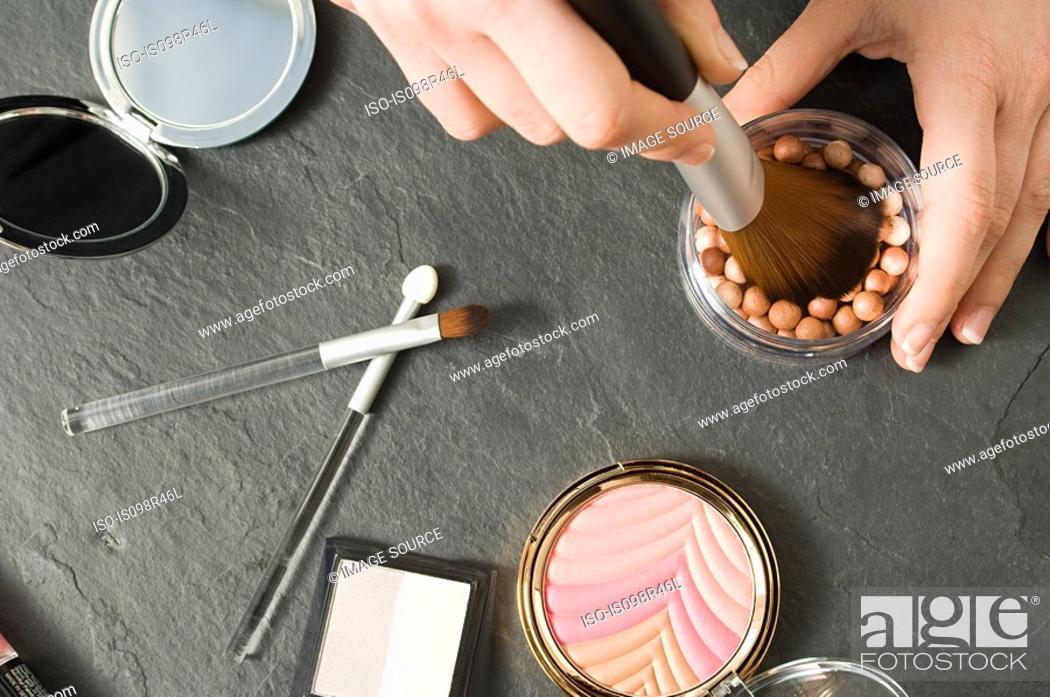 Stock Photo: Woman using makeup.