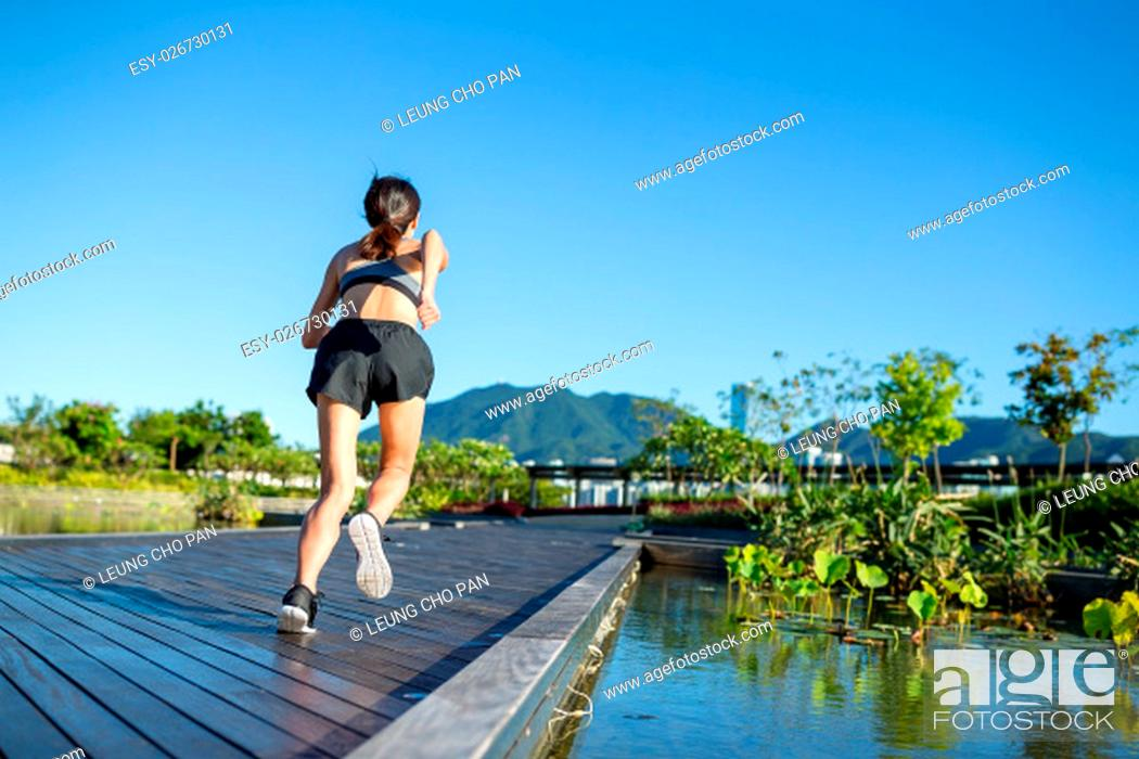 Stock Photo: Woman running in outdoor park.